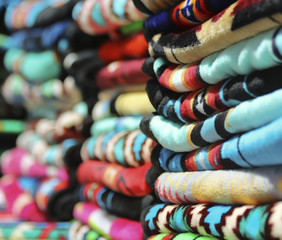 An Assortment of Colorful Stacked Blankets Arranged in a Row