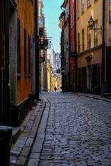 Stockholm, Sweden - June 01, 2017 - A tourist walking along the old street of Stockholm in sunnyday