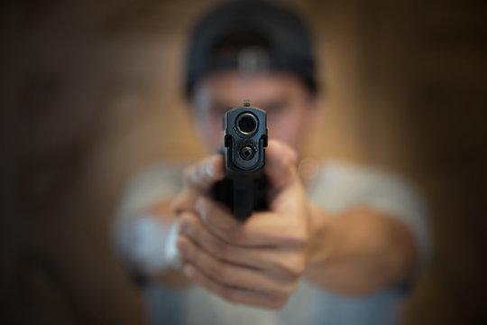 hand pointing a gun forward