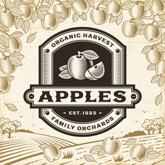 Retro apples label on harvest landscape. Editable EPS10 vector illustration in woodcut style with clipping mask and transparency.