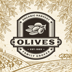 Retro olives label on harvest landscape. Editable EPS10 vector illustration in woodcut style with clipping mask and transparency.