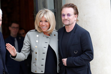 Singer Bono of Irish band U2 and co-founder of ONE organization and Brigitte Macron, wife of the French President, speak at the Elysee Palace in Paris