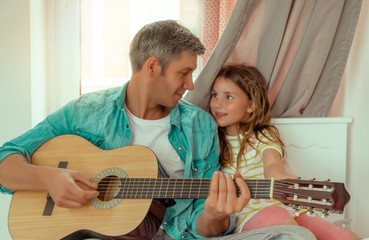 dad plays music for daughter