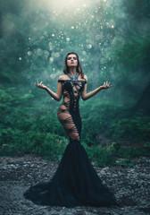 The evil queen is walking in the woods. Wild Princess , vampire, creative color, dark boho