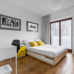White bedroom with bed and desk