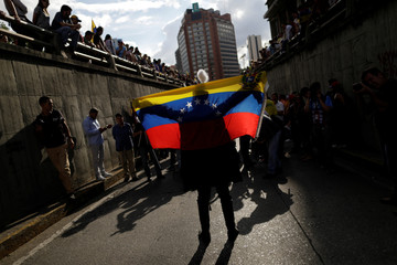Opposition supporters attend a rally to pay tribute to victims of violence during protests against Venezuelan President Maduro's government in Caracas
