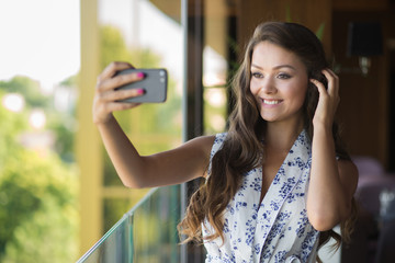 Portrait of stylish young woman take selfie with smartphone