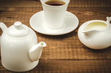 white ware for coffee/white ware for coffee on a wooden background