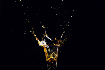 Printed roller blinds Splashing water Isolated shot of whiskey with splash on black background, brandy in a glass