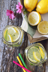 Two glasses of cool refreshing drink: pure water,  lemon and mint. Top view