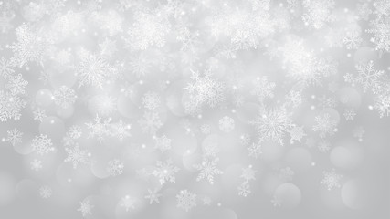 Christmas background of snowflakes with bokeh effect in white