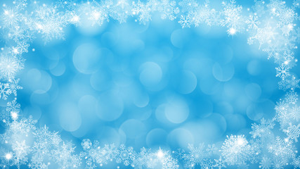 Christmas background with frame of snowflakes and bokeh effect in light blue