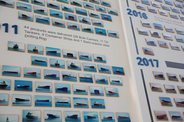 Ship images are seen at a showroom of Shanghai Waigaoqiao Shipbuilding Co., Ltd. in Shanghai
