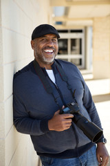 African American Man Smiling Holding A Camera