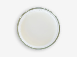Top view of milk glass on white