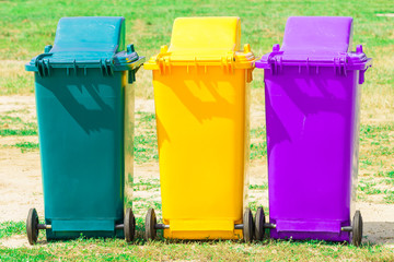 Three plastic bin in the park