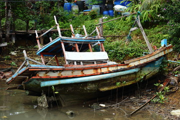 Old Sink fishing boat dock dead along mangrove canal river forest jungle
