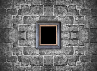 Picture frame hanging on stone brick wall, vintage frame and wall