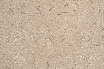 Christmas trees pattern drawing in sand