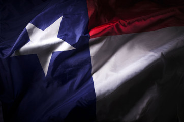 Aluminium Prints Texas The Texas state flag waving in shadow