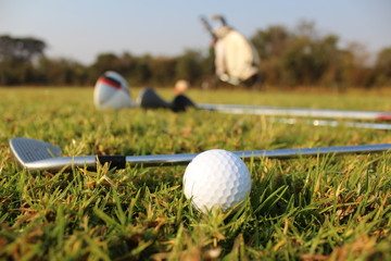 Golf clubs and golf balls: playing golf