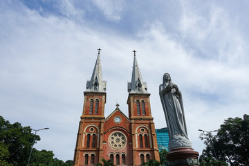 Notre Dame Cathedral (Vietnamese: Nha Tho Duc Ba) in a beautiful weather, build in 1883 in Ho Chi Minh city, Vietnam. HOCHIMINH CITY (SAI GON), VIET NAM - July 11, 2017