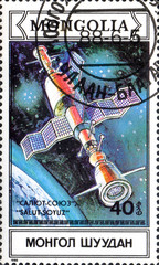 UKRAINE - CIRCA 2017: A postage stamp printed in Mongolia shows Docking in space of spacecraft Soyuz and Salut from series Space research, circa 1988