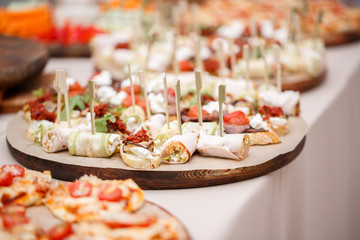 Assorted canape with cheese, meat, rolls, bakery and vegetables. selective focus