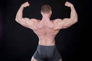 Sport the athlete bodybuilder shows off his muscles