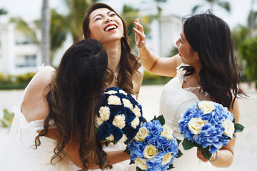 Bride and bridesmaids have fun posing outside