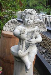 Cupids statue in public park.
