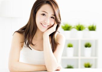 closeup smiling young  woman face.