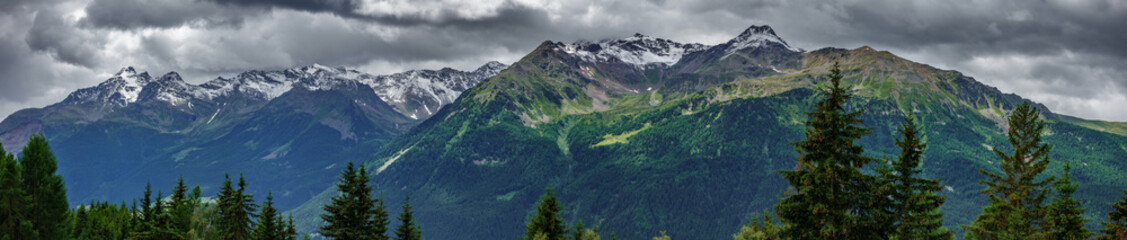 Ultra wide panorama of top of mountains in Italian Alps