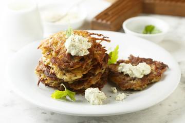 Potato latkes with cream cheese and herbs