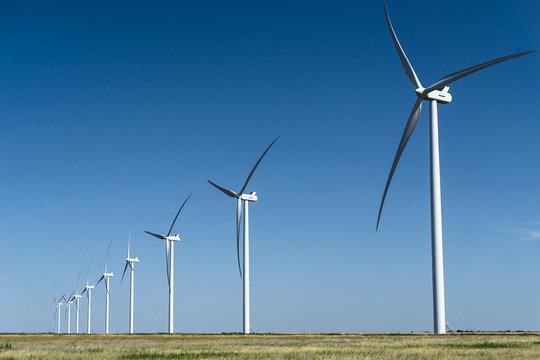 a row of wind turbines on a wind farm in Texas