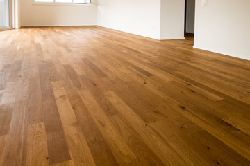wooden parquet floor of empty apartment ready to be moved into