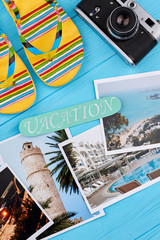 Concept of summer vacation. Flip-flop, camera, message, different pictures.