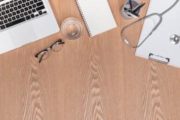 Wooden doctor desk background, horizontal medical concept copy space