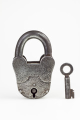 Old rusty padlock and key  isolated  background