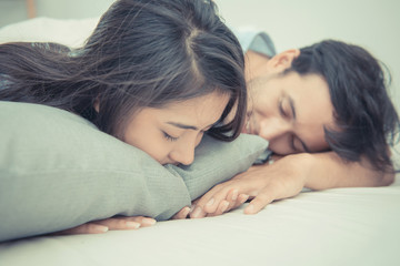 Young couple sleeping and relaxing on the bed in bedroom
