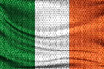 National flag of Ireland on wavy fabric with a volumetric pattern of hexagons. Vector illustration.