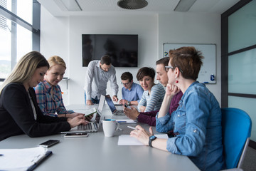 Group of young people meeting in startup office