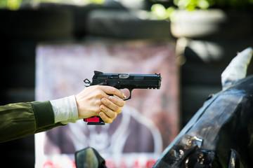 Woman's shooting a gun at Shooting range