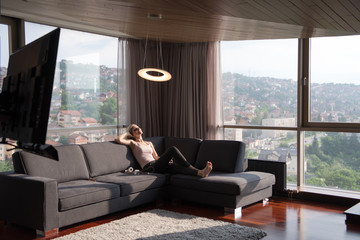 woman using tablet in beautiful apartment
