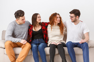 Happy young friends, casual people sitting on couch