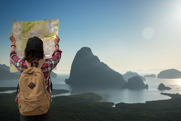 Traveler tourist asia women with map travel see the mountain veiw in the sunrise.  Travel Concept