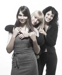 Three beautiful woman friends posing