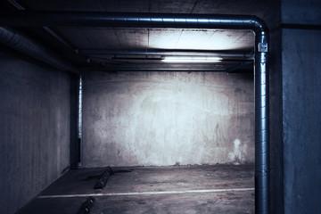 Urban underground background. Concrete wall under the lamp light in the dark.