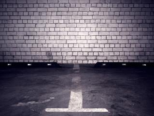 Urban underground background. White brick wall in the dark.