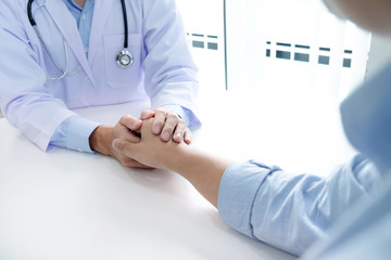 Hand of doctor reassuring his patient